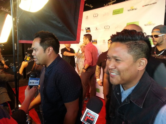 Guest Hosts Manny Streetz and Dante Basco making their way down the media line.